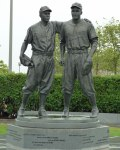 A statue of Pee Wee Reese and Jackie Robinson outside MCU Park