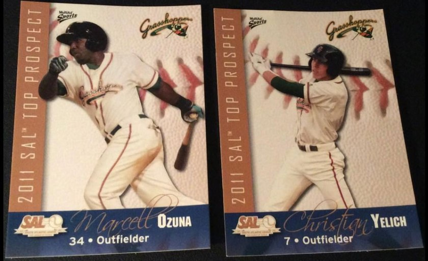 Marcell Ozuna and Christian Yelich's baseball cards from the 2011 South Atlantic League Top Prospects set