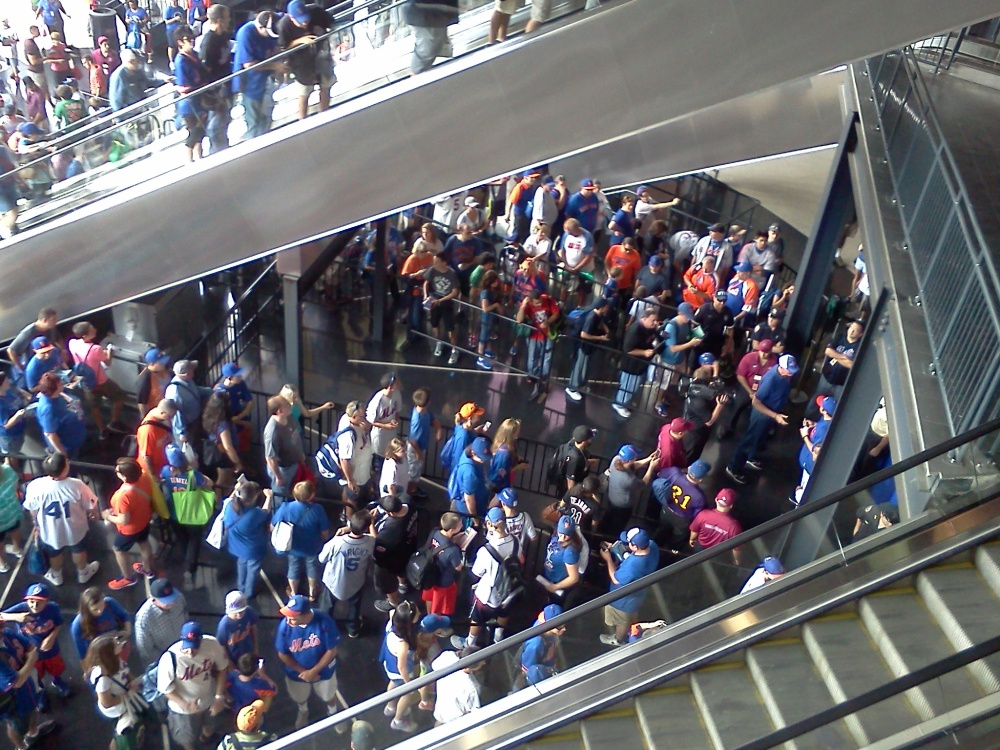 Mets fans wait for their turn to get an autograph from Travis d'Arnaud before the team's final game on Sept. 28, 2014. (Photo credit: Paul Hadsall)