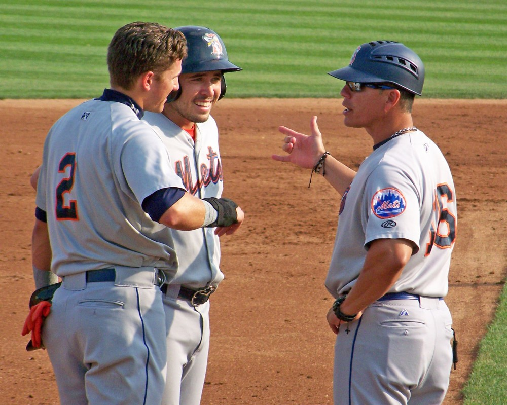 Binghamton Mets manager Pedro Lopez (right) shares words with Gavin Cecchini (2) and Travis d'Arnaud during a Trenton Thunder mound visit (Photo credit: Paul Hadsall)